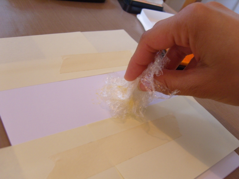 Use cling film to ink a textured border on a birthday card - tutorial